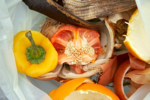 Stock Photo: 1672R-55678 Green organic kitchen waste in a biodegradable plastic bag