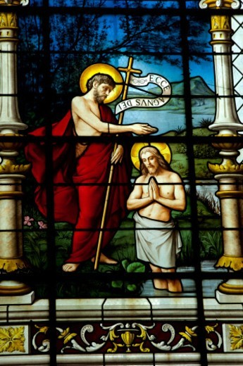 Stock Photo: 1672R-56203 A panel of stained glass, in an old Cathedral, shows John the Baptist baptizing Jesus.