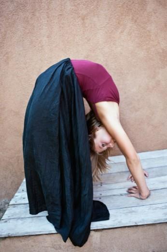 Girl (10 yrs old) doing gymnastics - back bend : Stock Photo
