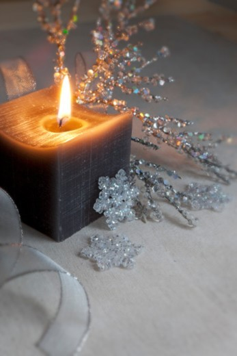 Elegant winter candle glowing : Stock Photo