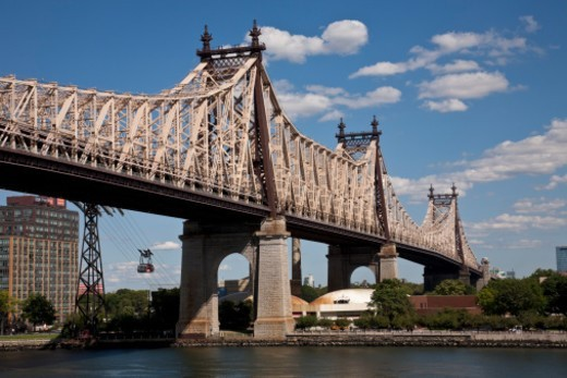 The Ed Koch Queensboro Bridge, also known as the 59th Street Bridge ? because its Manhattan end is located between 59th and 60th Streets ? or simply the Queensboro Bridge, is a cantilever bridge over the East River in New York City that was completed in 1909. : Stock Photo