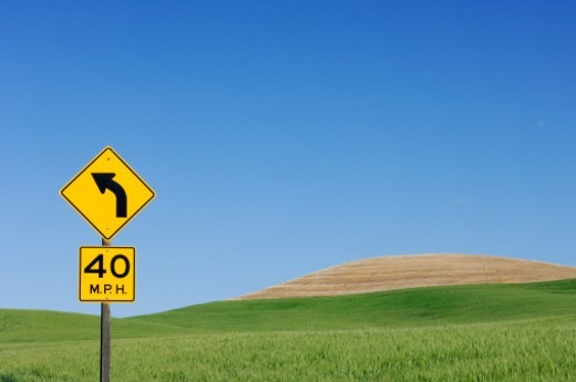 Stock Photo: 1672R-58044 Traffic sign with fields in background, near Colfax at the Palouse Region. The verdant Palouse stretches across more than 2 million acres in eastern Washington and western Idaho. Near Colfax, Palouse, Whitman County, Washington State, USA, America.