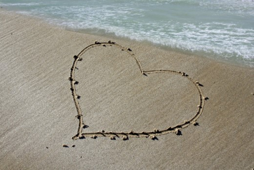Heart drawn on the sand. : Stock Photo
