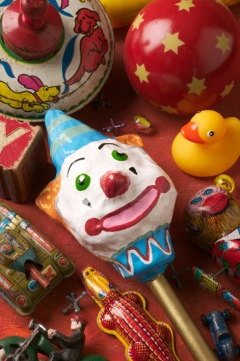 Clown rattle with old toys still life : Stock Photo