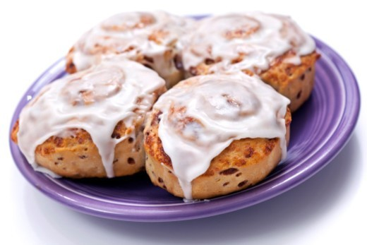 Stock Photo: 1672R-60219 Cinnamon rolls with frosting on a small plate.