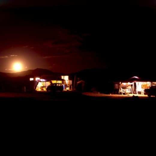 Stock Photo: 1672R-60620 The moon rises over campground next to the Pacific Ocean.