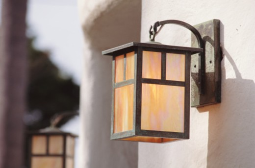 Stock Photo: 1672R-6068 Porch lights on exterior of house (focus on porch light in foreground)
