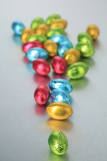 Stock Photo: 1672R-60680 Chocolate Easter eggs on metal background illustrating concepts