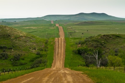 gravel country road in North Dakota : Stock Photo