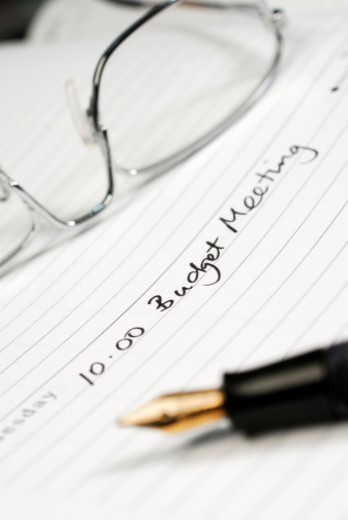 Stock Photo: 1672R-61495 Close up of a diary entry for a budget meeting with selective focus and limited depth of field