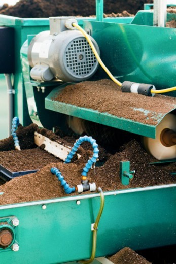 Seeding equipment and seeds being planted in a Greenhouse. The plants grown here will be used for the farming industry. : Stock Photo