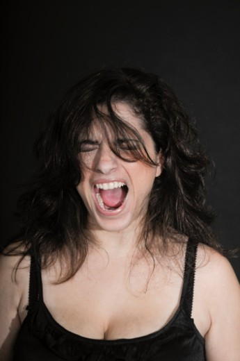 Stock Photo: 1672R-62511 Young woman shouts in rage