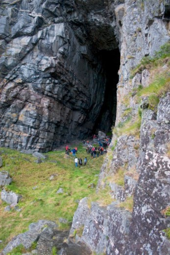 People gathering in a cave in the mountains : Stock Photo