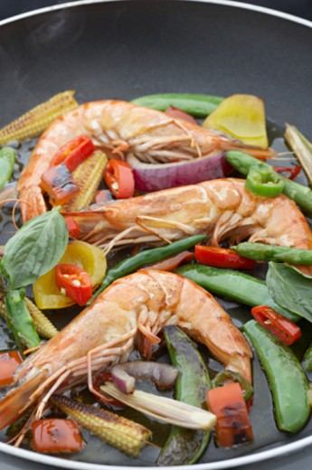 Stock Photo: 1672R-6359 King prawn stir fry in wok