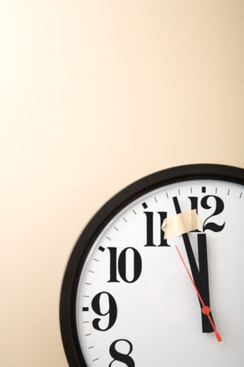 Taped down minute hand on clock : Stock Photo