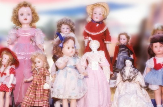 Antique dolls at a flea market : Stock Photo