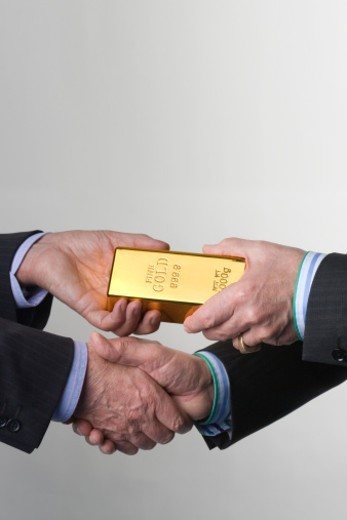 Stock Photo: 1672R-64658 Two men handshake on a gold exchange