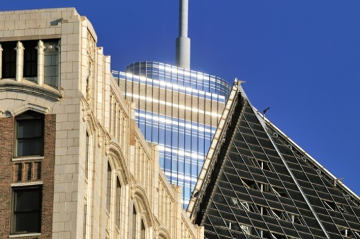 Stock Photo: 1672R-64679 A compressed view of a trio of roof lines. At rear, rising above its neighbors is the ultra-modern Trump Tower, completed in 2009 it is the second tallest building in Chicago. At left is the Illinois State Society Building, dating to 1885, and at right is the Smurfit-Stone Building, built in 1984.