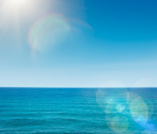 Stock Photo: 1672R-65337 Turquoise seascape with sun flairs