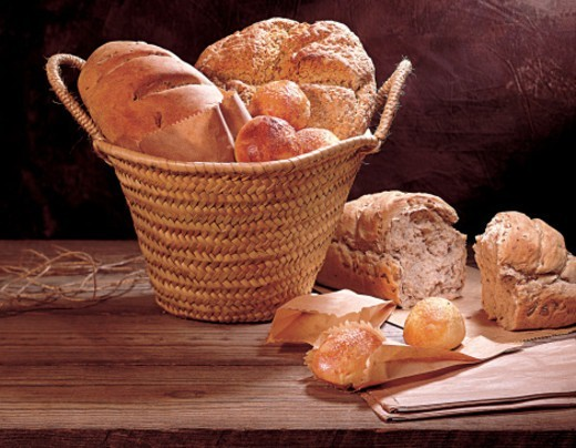 Stock Photo: 1672R-65628 Various types of freshly baked bread and rolls including wholewheat, rye and Challah.
