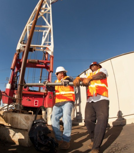 Stock Photo: 1672R-65638 Workmen working together to install piping