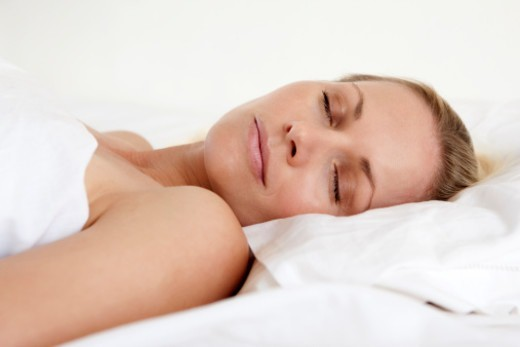 Stock Photo: 1672R-66091 Young woman asleep in bed
