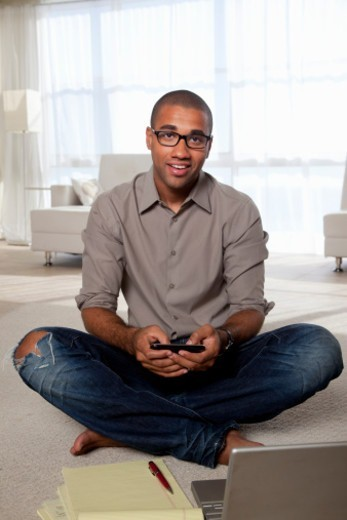 A mixed race man, working at home : Stock Photo