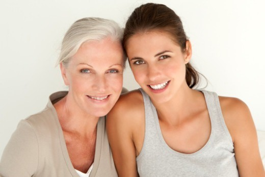 Stock Photo: 1672R-66554 Portrait of a mother and her daughter smiling