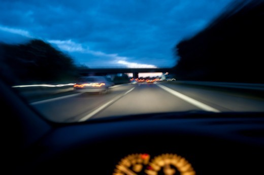 Driving on an autobahn  at dusk : Stock Photo