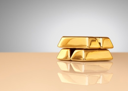 Stock Photo: 1672R-66620 A stack of four gold ingots