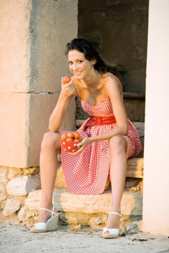 A women with tomatoes : Stock Photo