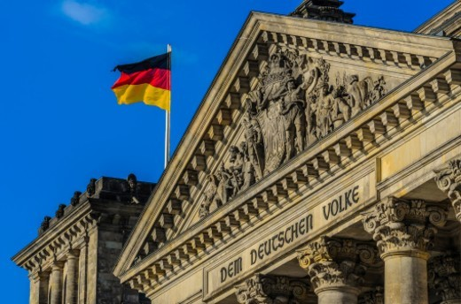 The Reichstag (German Parliament) with German flag : Stock Photo