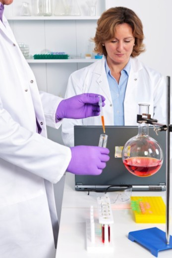 Stock Photo: 1672R-68504 Scientists at work in a laboratory