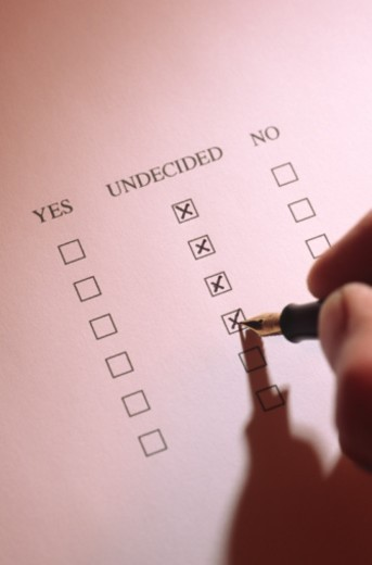Stock Photo: 1672R-6867 Man filling in questionnaire, close-up of hand