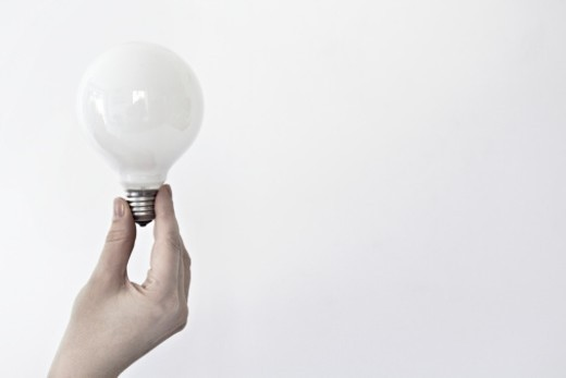 Stock Photo: 1672R-69472 Hand holding a lightbulb