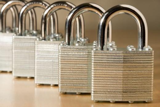 Row of padlocks (focus on padlock in foreground) : Stock Photo