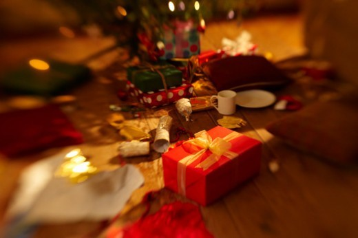 Stock Photo: 1672R-71417 Christmas presents surrounded by mess