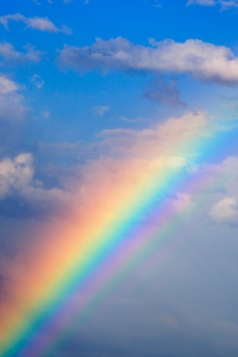Rainbow with blue sky and clouds : Stock Photo