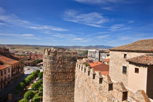 The medeival city walls of Avila and the town : Stock Photo