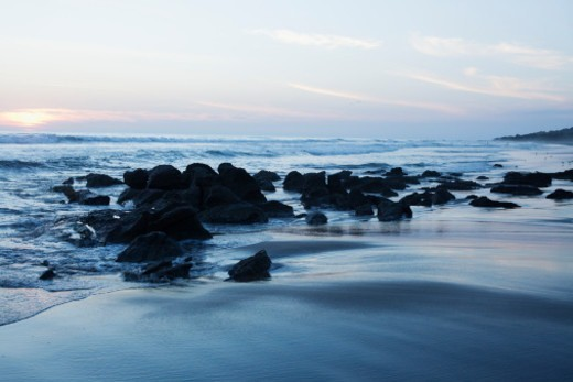 Rocks on the sea shore at dusk : Stock Photo