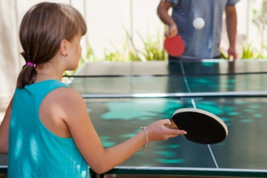 Stock Photo: 1672R-73531 Young girl playing ping pong, or table tennis