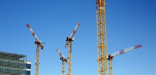 Cranes on a building construction site : Stock Photo