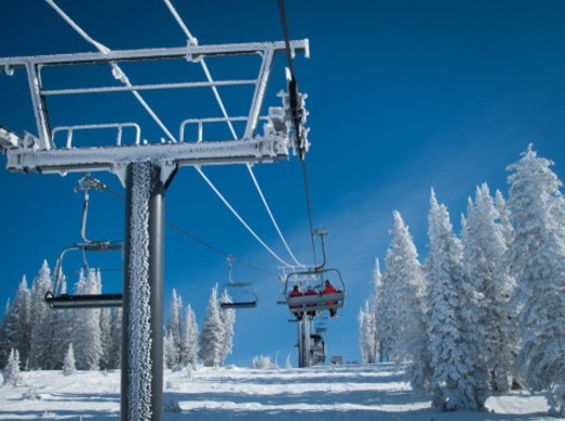 Stock Photo: 1672R-74443 People using the chair lift at a ski resort