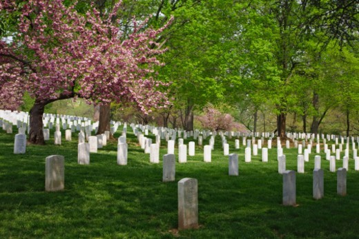Tombstones mark the burial sites of American soldiers. Arlington National Cemetery is America's most sacred cemetery dedicated to her military dead, located on the former estate of General Robert E. Lee. : Stock Photo