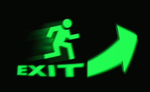 Stock Photo: 1672R-74583 Exit sign with arrow, running man and motion blur