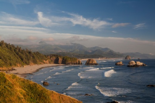 Oregon Coast rock formations, including the Haystack Rock, Pacific Ocean, Cannon Beach, Oregon, USA.  View from Ecola State Park. : Stock Photo