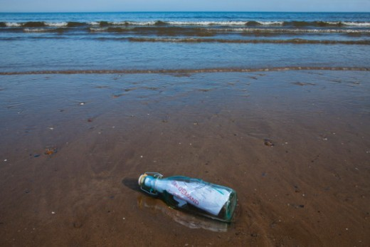 Stock Photo: 1672R-74938 Tax demand notice in a bottle washed up on a beach