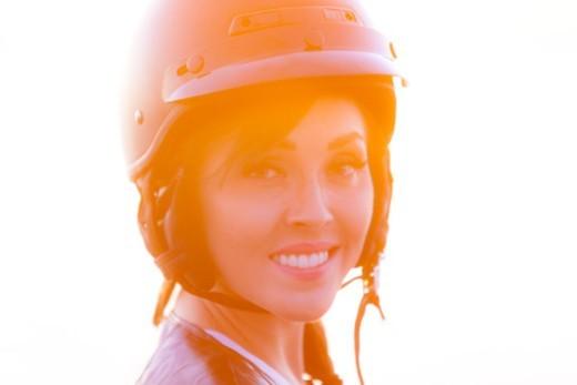 Smiling woman wearing a motorbike helmet : Stock Photo