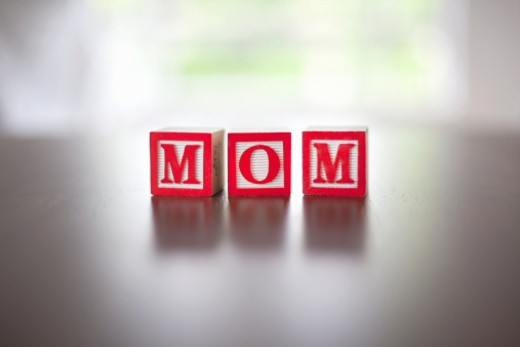 Alphabet blocks spelling the word 'Mom' : Stock Photo