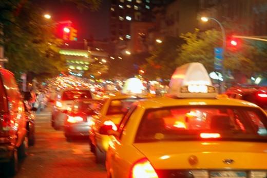 Yellow cabs at night, Manhattan, New York City : Stock Photo